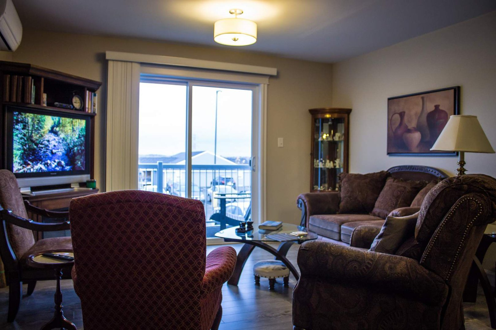 Mid-Rise-Apartment for rent at 747 Coverdale Road, Moncton, NB. This is the living room with natural light and hardwood floor.