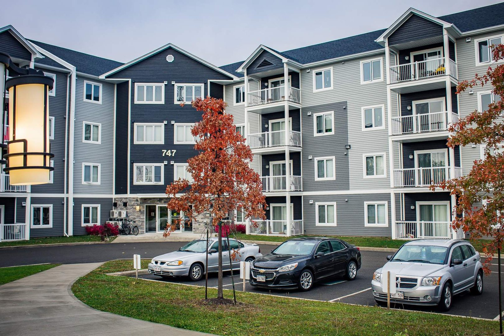 Mid-Rise-Apartment for rent at 747 Coverdale Road, Moncton, NB. This is the outdoor building with lawn.