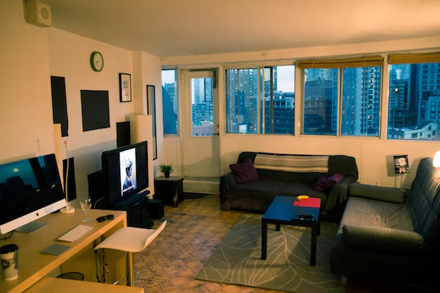 Apartment for rent at 235 Rue Sherbrooke Ouest, Montréal, QC. This is the living room with natural light.