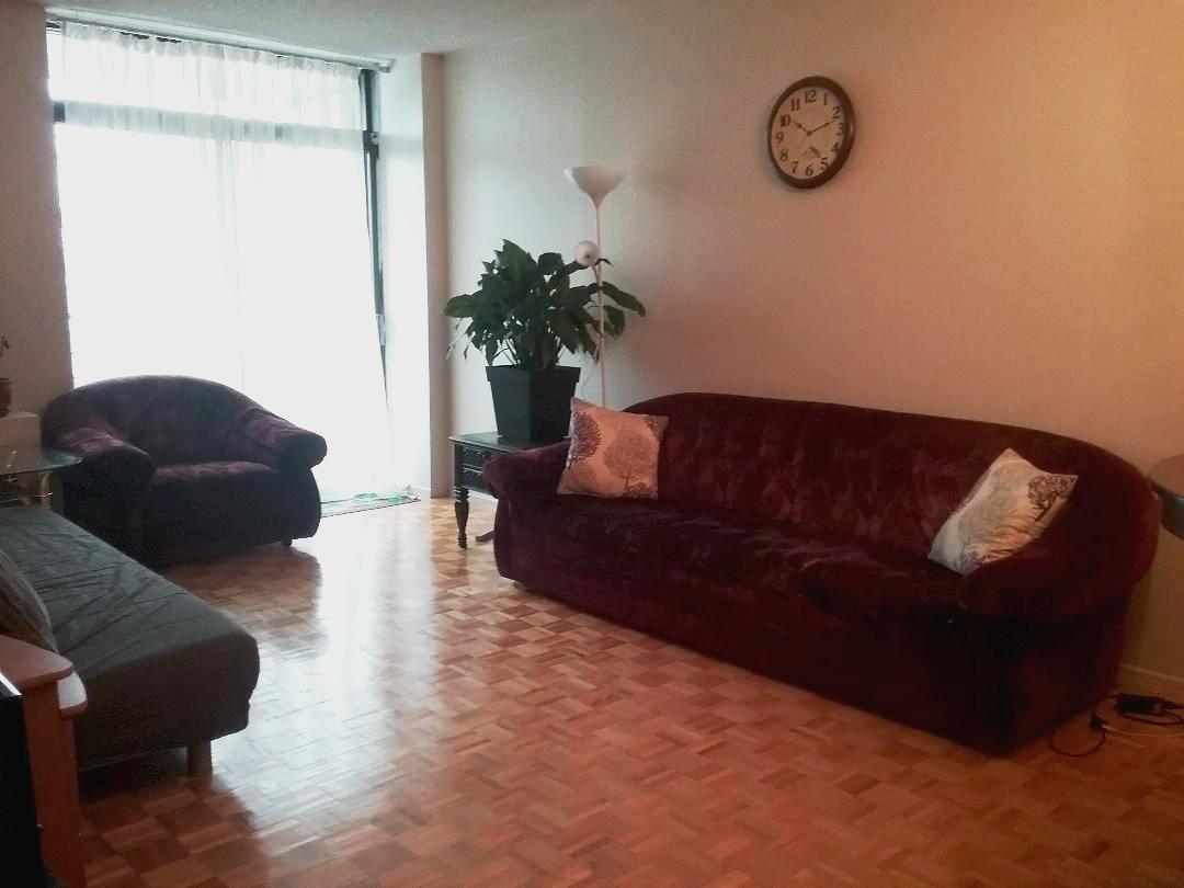 Apartment for rent at 10500, Acadie, Montréal, QC. This is the living room with hardwood floor and natural light.