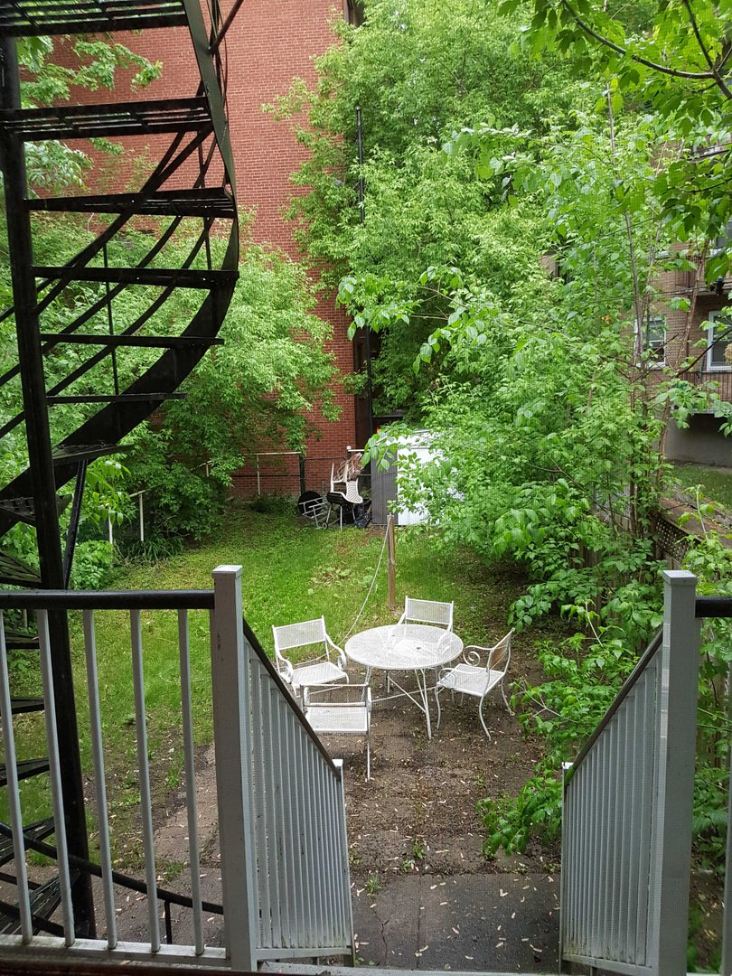Apartment for rent at 4649 Avenue Clanranald, Montréal, QC. This is the backyard with deck.
