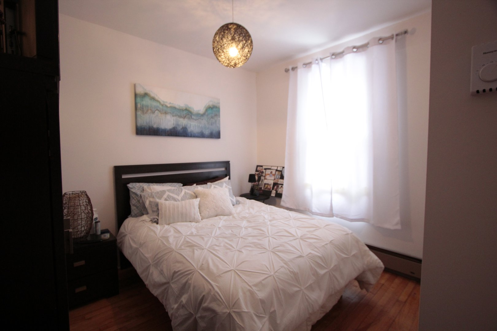 Apartment for rent at 4649 Avenue Clanranald, Montréal, QC. This is the bedroom with natural light and hardwood floor.