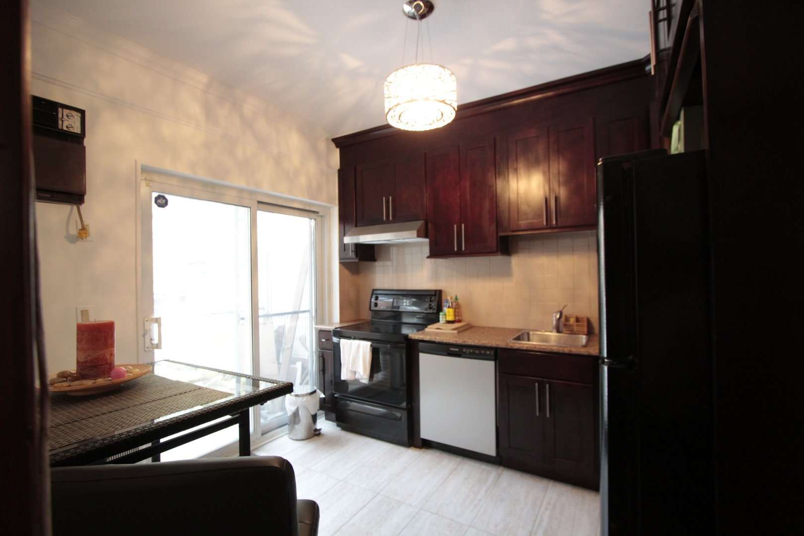 Apartment for rent at 4649 Avenue Clanranald, Montréal, QC. This is the kitchen with natural light, stainless steel and hardwood floor.