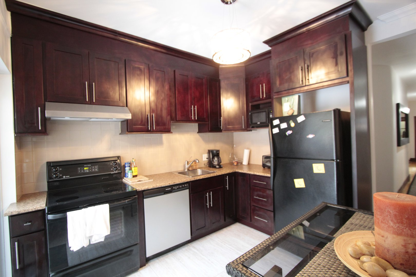 Apartment for rent at 4649 Avenue Clanranald, Montréal, QC. This is the kitchen with stainless steel and hardwood floor.