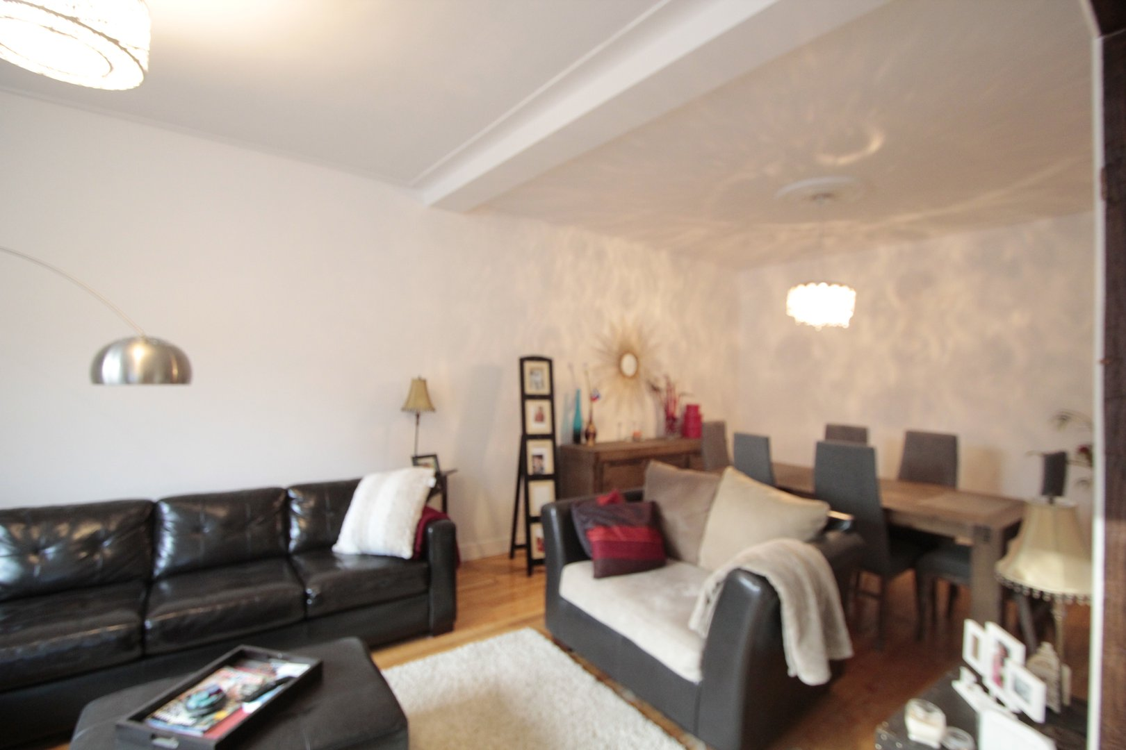 Apartment for rent at 4649 Avenue Clanranald, Montréal, QC. This is the living room with beamed ceiling and hardwood floor.