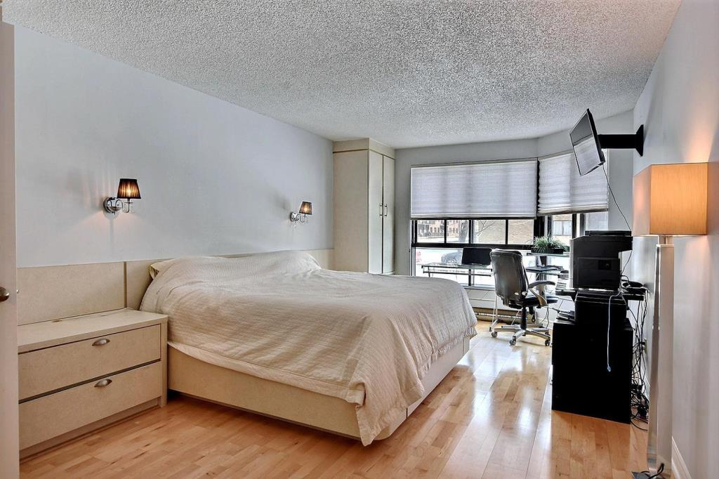 Apartment for rent at 1500 Rue Todd Apt. 102, Montréal, QC. This is the bedroom with hardwood floor.