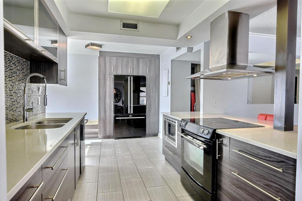 Apartment for rent at 1500 Rue Todd Apt. 102, Montréal, QC. This is the kitchen with tile floor and stainless steel.