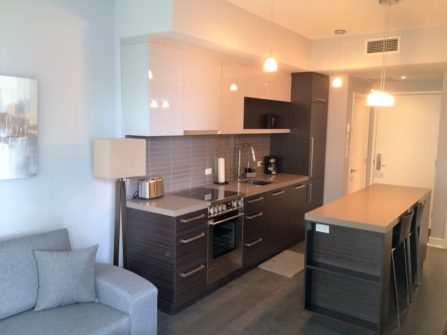 Condo for rent at 1050 Rue Drummond, Montréal, QC. This is the kitchen with stainless steel and carpet.