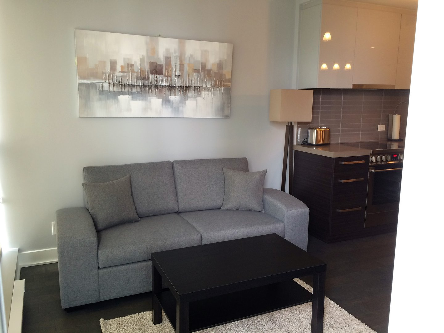 Condo for rent at 1050 Rue Drummond, Montréal, QC. This is the living room with hardwood floor.