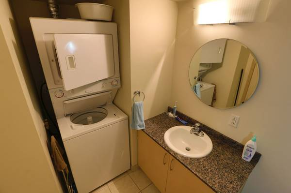 Condo for rent at 88 Rue Charlotte, Montréal, QC. This is the bathroom with tile floor.