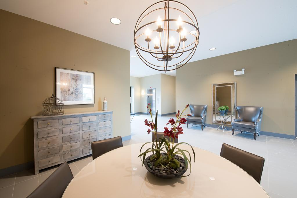 Bachelor for rent at 1820 Summerhill Place, Nanaimo, BC. This is the dining area with tile floor and notable chandelier.