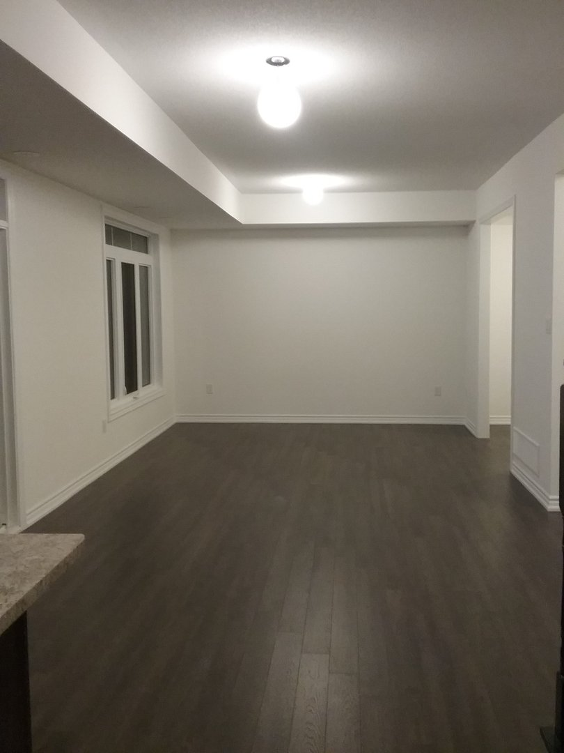 House for rent at 1710 Rex Heath Drive, Pickering, ON. This is the empty room with carpet.