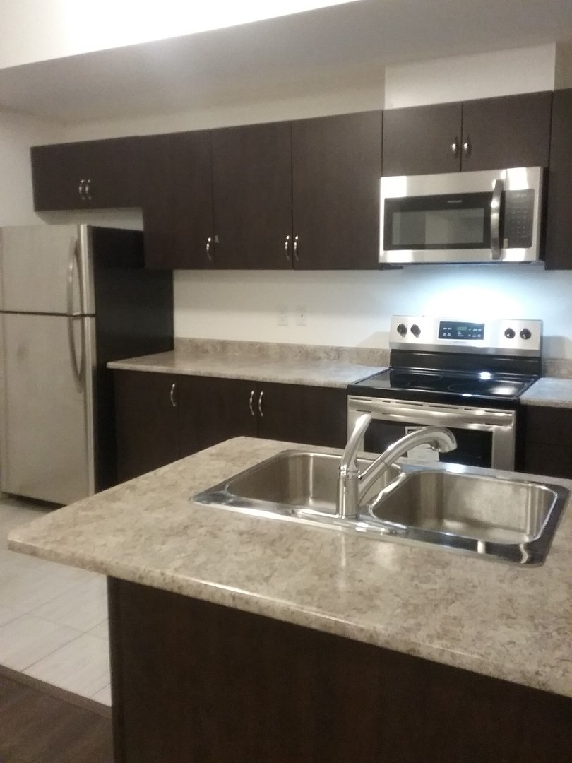 House for rent at 1710 Rex Heath Drive, Pickering, ON. This is the kitchen with tile floor, kitchen island and stainless steel.