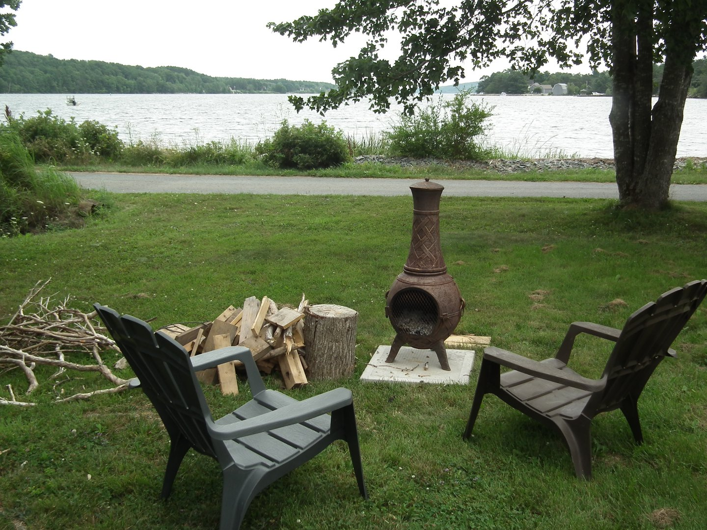 House for rent at 1751 NS-331, Pleasantville, NS. This is the backyard with water view and lawn.