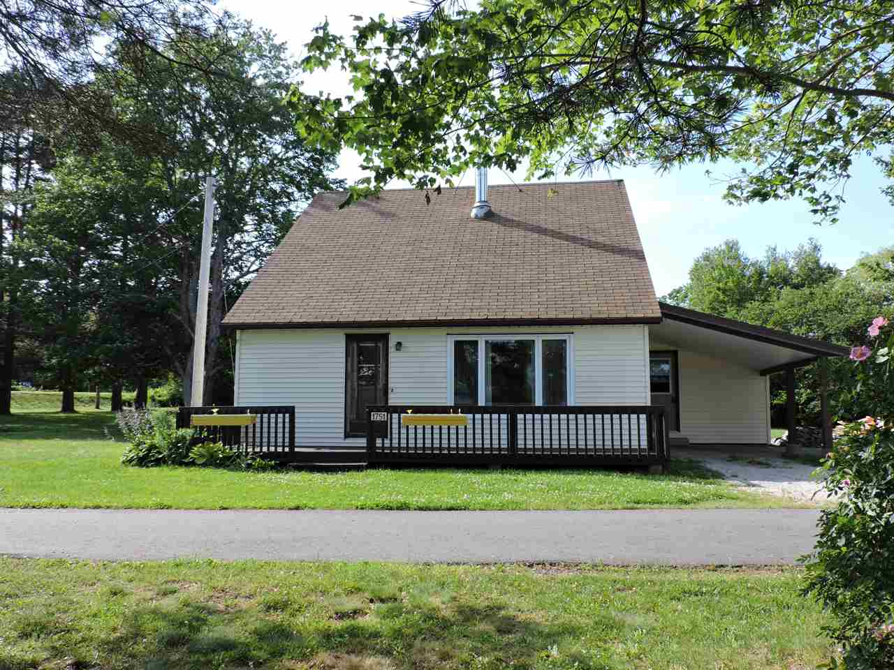 House for rent at 1751 NS-331, Pleasantville, NS in farmhouse style. This is the front of the house with lawn.