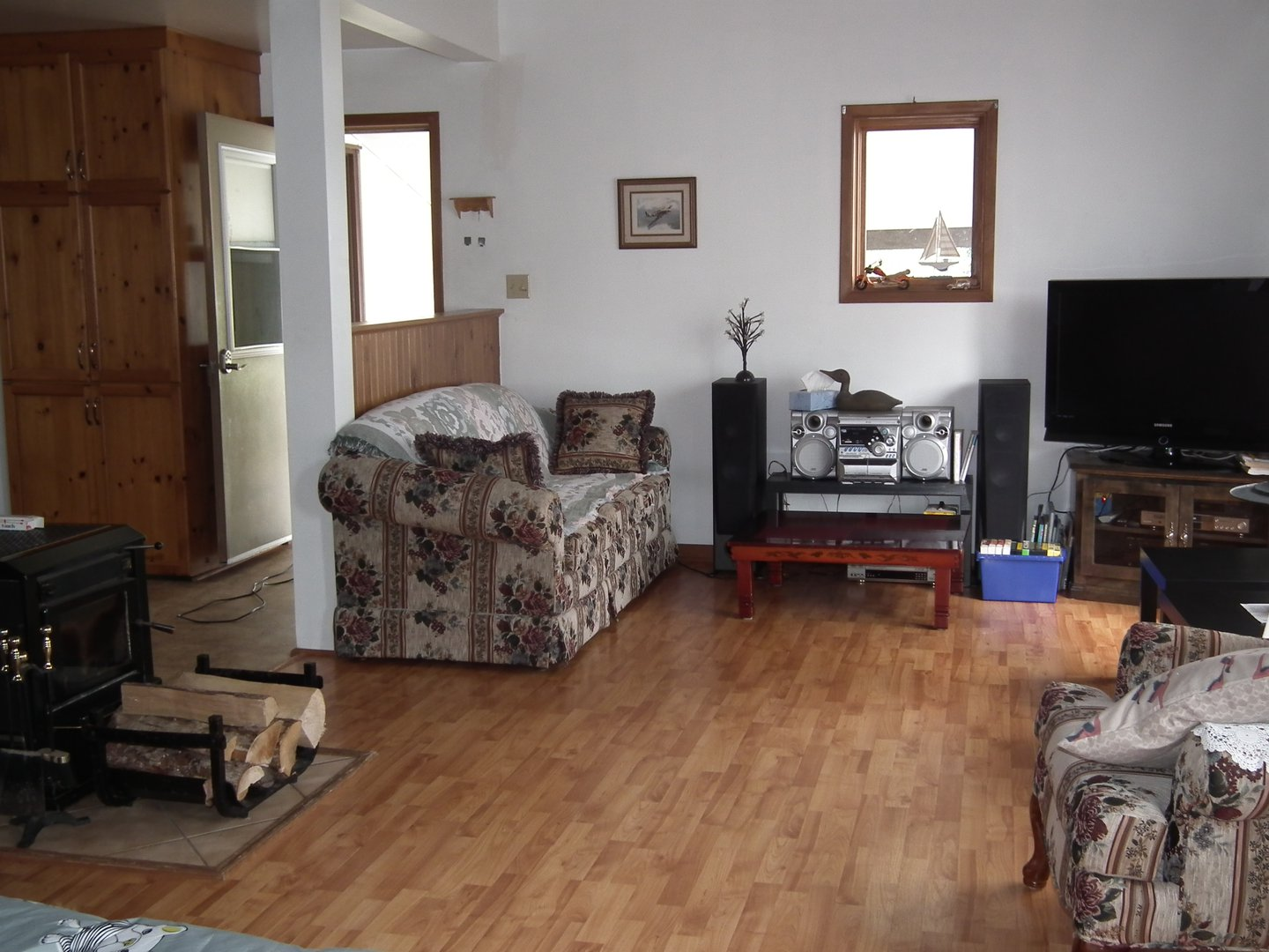 House for rent at 1751 NS-331, Pleasantville, NS. This is the living room with hardwood floor and natural light.