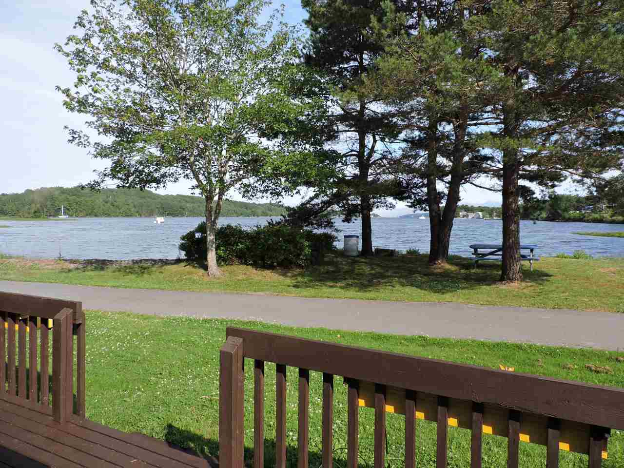 House for rent at 1751 NS-331, Pleasantville, NS. This is the patio terrace with water view, lawn and deck.
