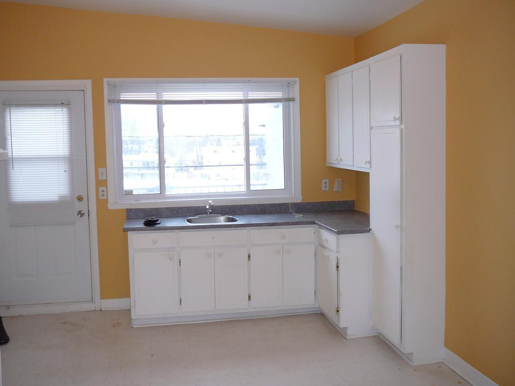 Apartment for rent at 768, avenue de, Québec City, QC. This is the kitchen with tile floor and natural light.