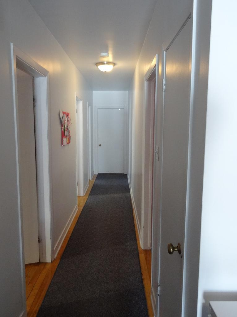 Apartment for rent at 780,787 rue, Québec City, QC. This is the corridor with carpet.