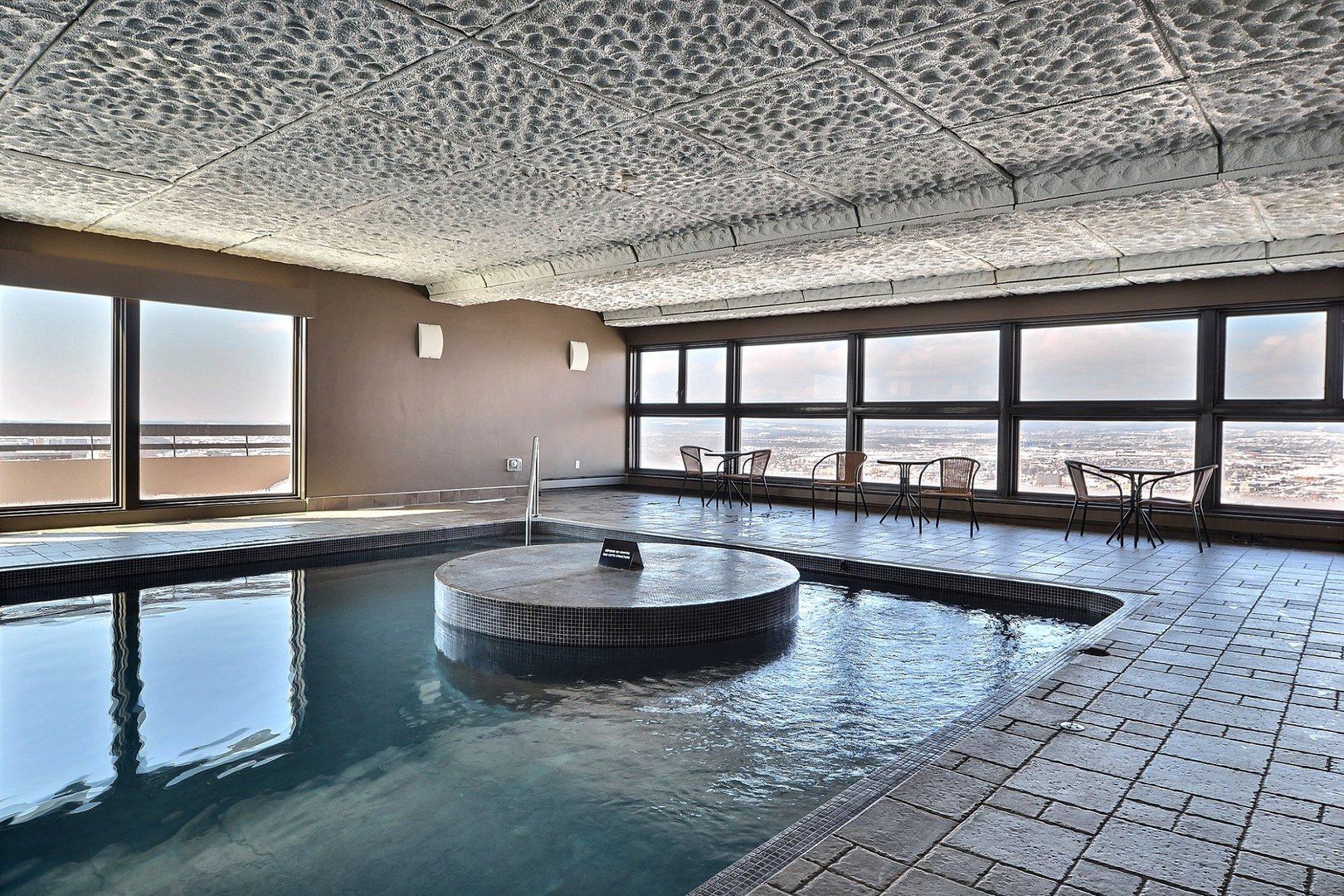 High-Rise Apartment for rent at 350 Chemin Sainte-Foy, bureau 1803, Québec City, QC. This is the pool with tile floor and natural light.
