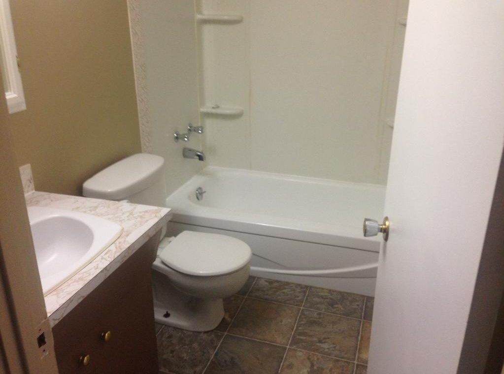 Apartment for rent at 4811-55 Street, Red Deer, AB. This is the bathroom with tile floor.