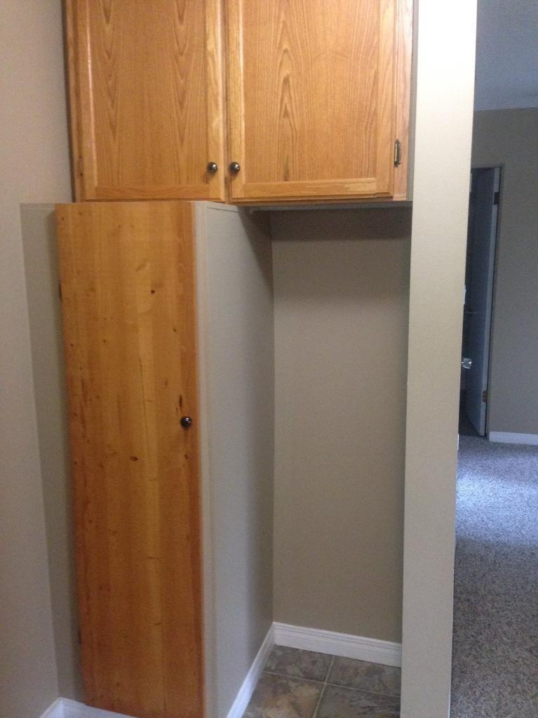 Apartment for rent at 4811-55 Street, Red Deer, AB. This is the details with tile floor and carpet.