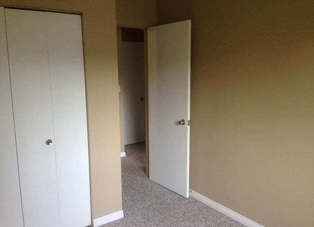 Apartment for rent at 4811-55 Street, Red Deer, AB. This is the empty room with carpet.
