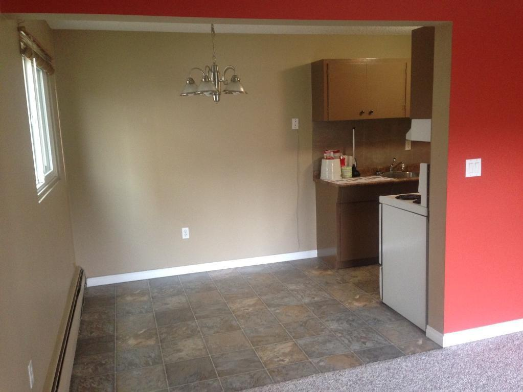 Apartment for rent at 4811-55 Street, Red Deer, AB. This is the empty room with tile floor.