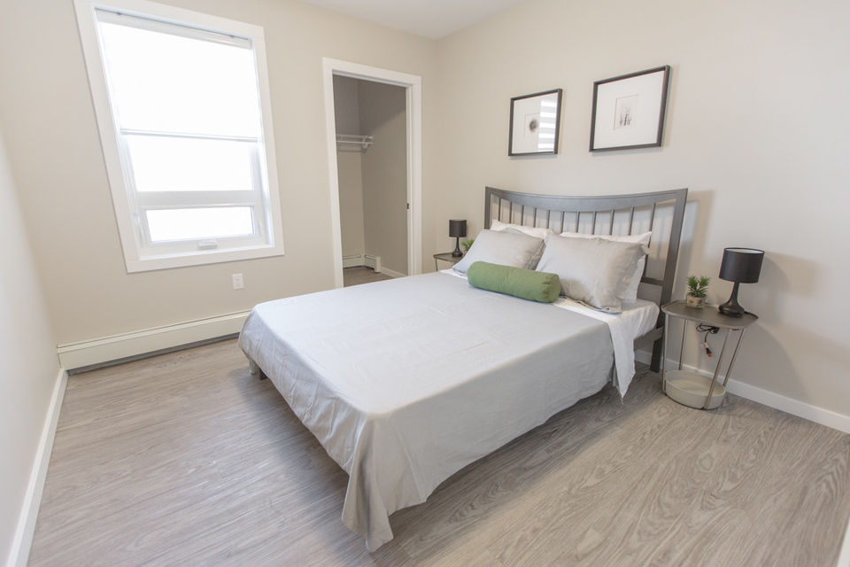 Apartment for rent at 4830 Gordon Rd, Richardson, SK. This is the bedroom with hardwood floor and natural light.