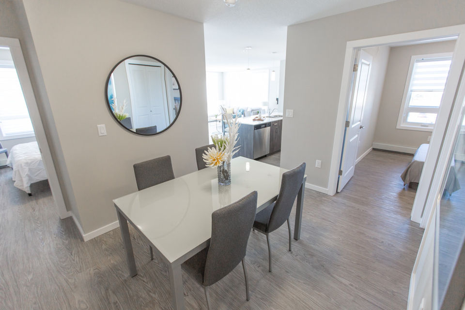 Apartment for rent at 4830 Gordon Rd, Richardson, SK. This is the dining area with hardwood floor and natural light.