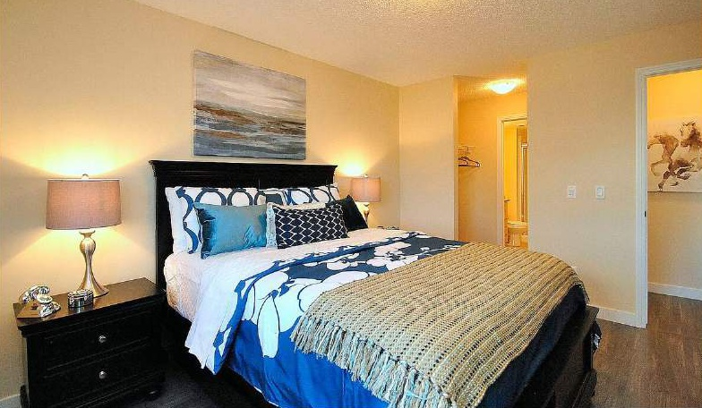 Apartment for rent at 4 & 6 Augustine Crescent, Sherwood Park, AB. This is the bedroom with hardwood floor and carpet.