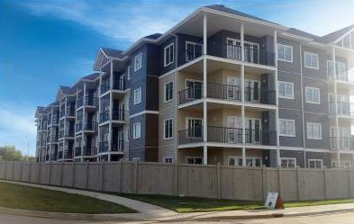 Apartment for rent at 4 & 6 Augustine Crescent, Sherwood Park, AB. This is the outdoor building with lawn.
