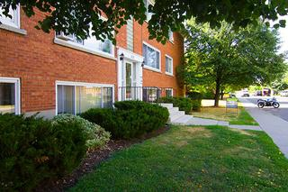 Apartment for rent at 377 Lafontaine Street, Vanier, ON. This is the outdoor building with lawn.