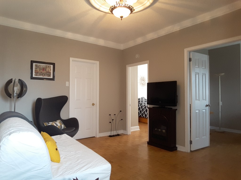 Apartment for rent at 229 Hannah St, Vanier, ON. This is the bedroom with hardwood floor.