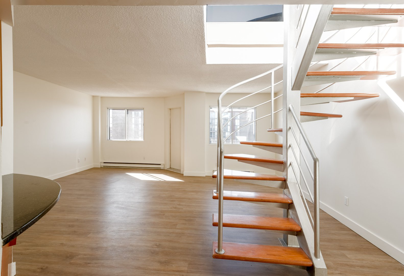 High-Rise Apartment for rent at 50 Quintin, suite 111, Ville Saint-Laurent, QC. This is the foyer entrance with hardwood floor and natural light.
