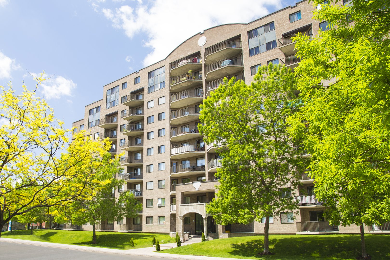 High-Rise Apartment for rent at 50 Quintin, suite 111, Ville Saint-Laurent, QC. This is the outdoor building with lawn.