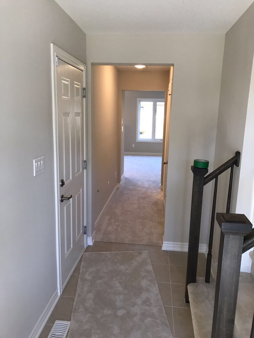 Apartment for rent at 285 Silverwood Ave, Welland, ON. This is the corridor with tile floor, natural light and carpet.