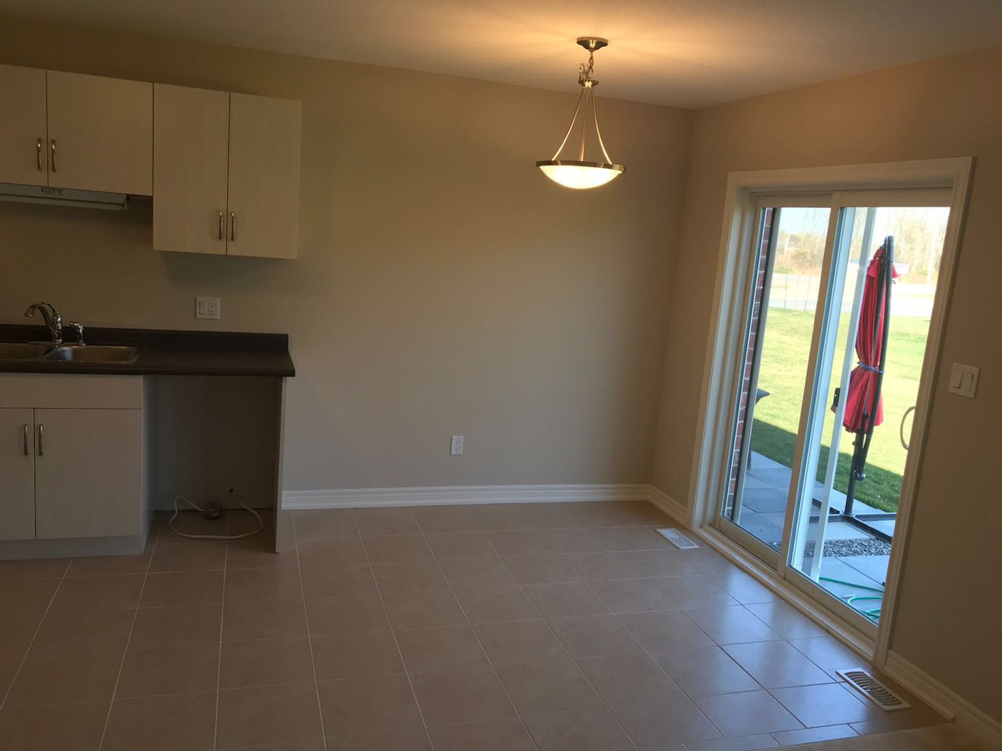 Apartment for rent at 285 Silverwood Ave, Welland, ON. This is the empty room with tile floor and natural light.