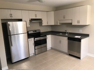 Apartment for rent at 285 Silverwood Ave, Welland, ON. This is the kitchen with tile floor, stainless steel and ceiling fan.