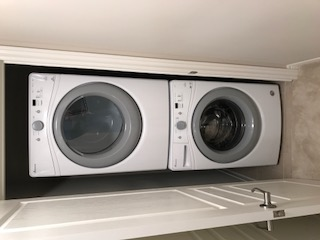 Apartment for rent at 285 Silverwood Ave, Welland, ON. This is the laundry room with hardwood floor.