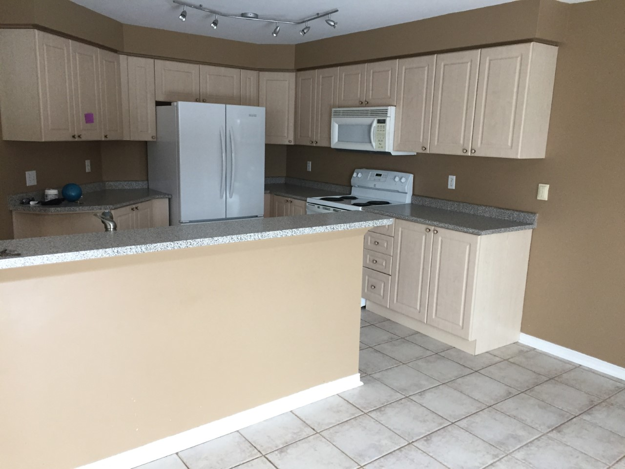 Apartment for rent at 11 Medland Ave, Whitby, ON. This is the kitchen with tile floor.