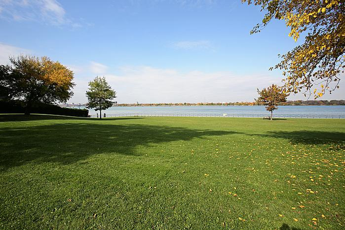 Not Sure for rent at 3445 Riverside Drive East, Windsor, ON. This is the backyard with lawn and water view.