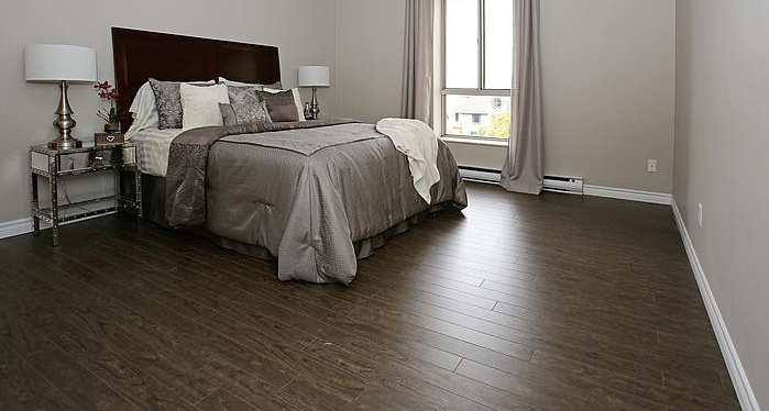 Not Sure for rent at 3445 Riverside Drive East, Windsor, ON. This is the bedroom with natural light and hardwood floor.
