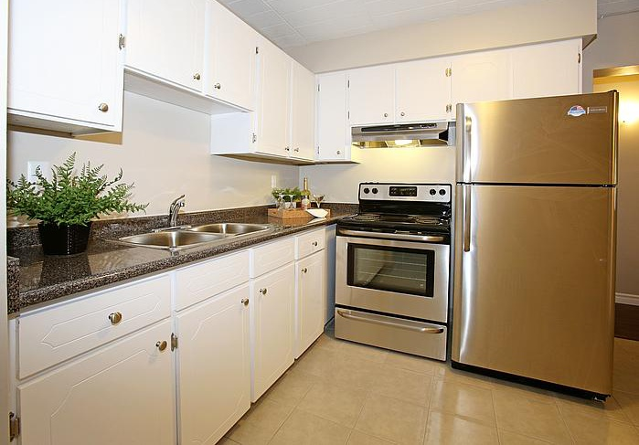 Not Sure for rent at 3445 Riverside Drive East, Windsor, ON. This is the kitchen with stainless steel and tile floor.