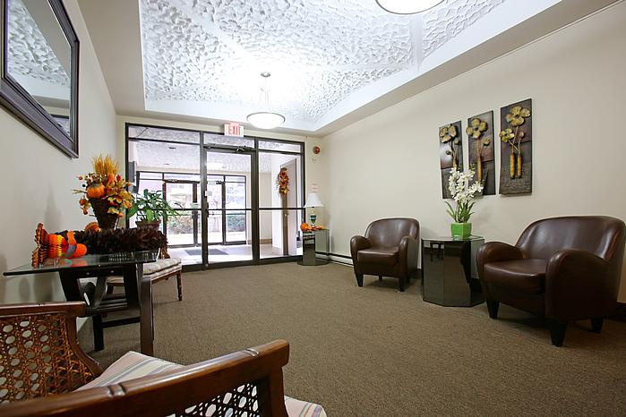 Not Sure for rent at 3445 Riverside Drive East, Windsor, ON. This is the living room with carpet and natural light.
