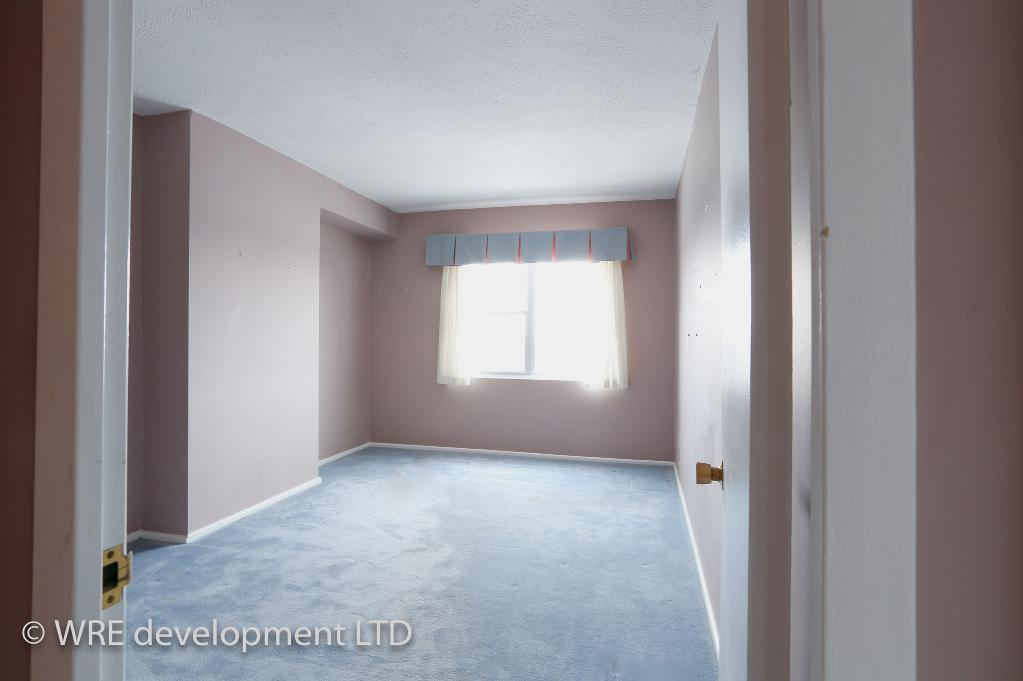 Apartment for rent at 2250 Portage Avenue, Winnipeg, MB. This is the empty room with carpet and natural light.