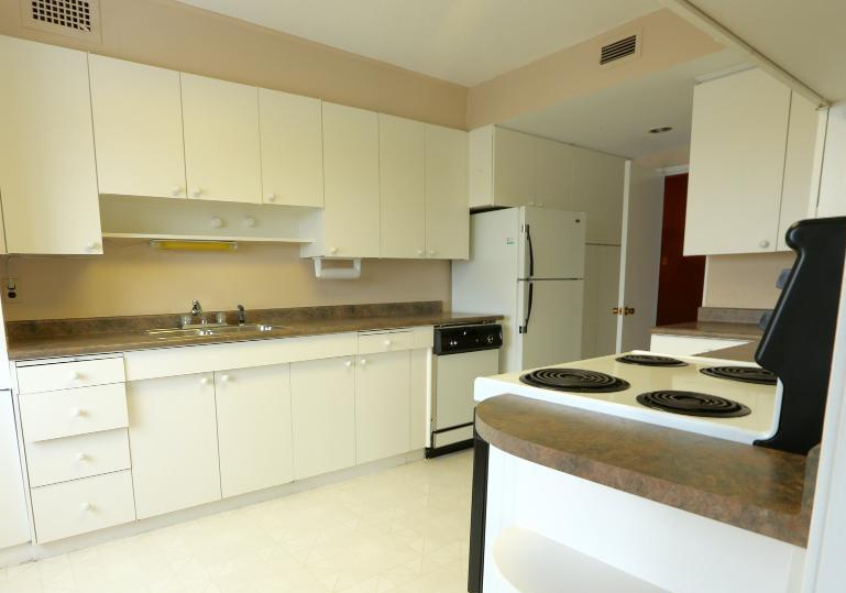 Apartment for rent at 2250 Portage Avenue, Winnipeg, MB. This is the kitchen with tile floor, refrigerator and dishwasher.