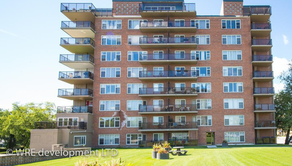 Apartment for rent at 2250 Portage Avenue, Winnipeg, MB. This is the outdoor building with lawn.